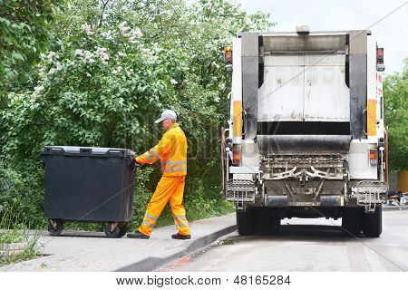 Worker of municipal recycling garbage collector truck loading waste and trash bin