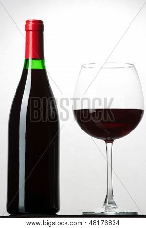 Wine Bottle And A Glass Filled With Wine Isolated On White