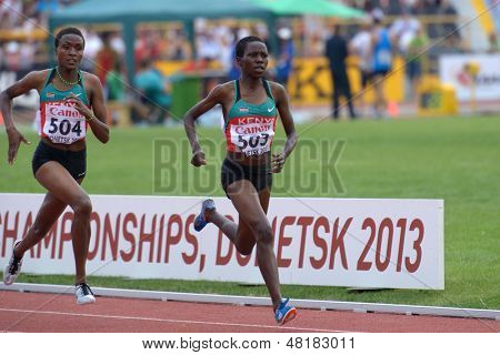 DONETSK, UKRAINE - JULY 14: Chepngetich (right) and Jepkemei, both of Kenya, fight for medals in the 2000 m steeplechase during 8th IAAF World Youth Championships in Donetsk, Ukraine on July 14, 2013