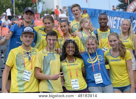 DONETSK, UKRAINE - JULY 14: Swedish team celebrate the gold medal of Irene Ekelund during 8th IAAF World Youth Championships in Donetsk, Ukraine on July 14, 2013