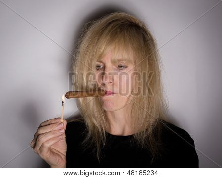 Woman Lights A Cigar