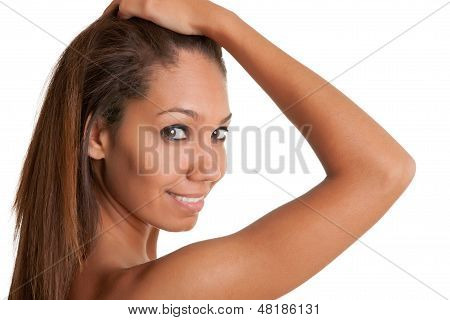 Beautiful African Woman Holding Her Hair And Smiling