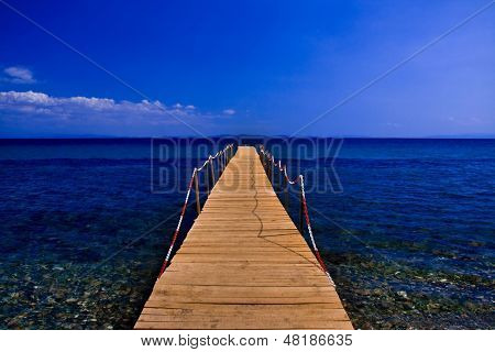 Pier On Blue Sea With Blue Sky