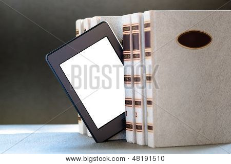 Ebook and books on table
