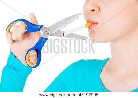 Quit smoking . Woman cutting cigarette with scissors.