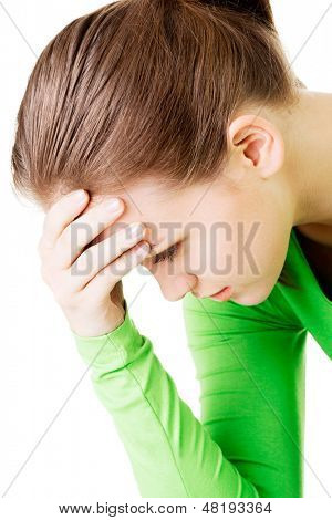 Junge schöne Frau in Depression. Isolated on white Background.