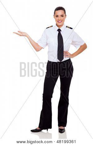 attractive female airline pilot presenting on white