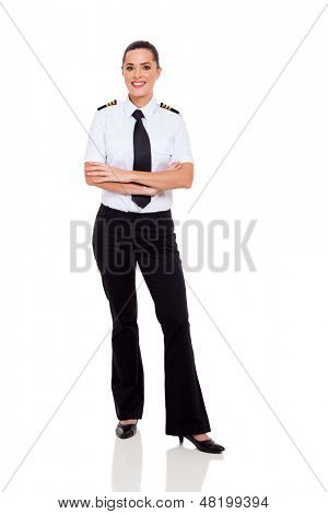 beautiful female young airline co-pilot with arms crossed isolated on white