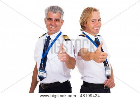 happy airline pilots giving thumbs up isolated on white