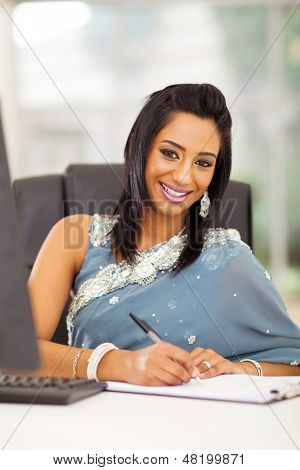attractive indian white collar worker in modern office