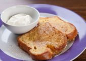 stock photo of french toast  - Simple dish of French toast with plain yogurt