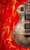 foto of fret  - black electric guitar on red velvet background - JPG