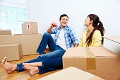 picture of key  - couple celebrating new home handing keys and moving boxes - JPG