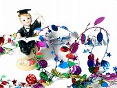 image of graduation cap  - graduate figurine and colorful party garland - JPG