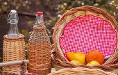 stock photo of nic  - Close up of Bottles and wicker baskets - JPG