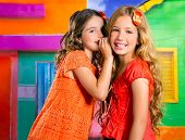 stock photo of girlie  - children friends girls whispering ear in vacation at tropical colorful house - JPG