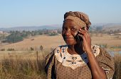 picture of zulu  - Traditional African Zulu woman speaking on mobile cell phone telephone in rural KwaZulu - JPG