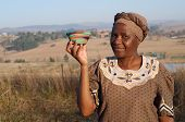 Traditional African Zulu Woman Selling Wire Baskets poster
