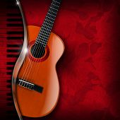 stock photo of serenade  - Acoustic brown guitar and piano against a red floral background - JPG