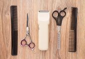 pic of electric trimmer  - Barber accessories on wooden table - JPG