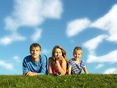 Family On Herb Under Blue Sky poster