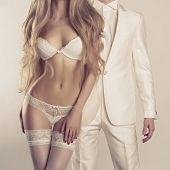 image of erotics  - Art photo of a young couple in sensual lingerie and a tuxedo - JPG