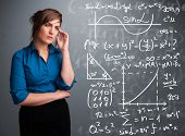 stock photo of mathematics  - Beautiful young school girl thinking about complex mathematical signs - JPG