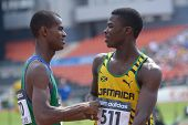 DONETSK, UKRAINE - JULY 14: O'Hara, Jamaica (right) accept congratulations from dos Santos, Brazil a