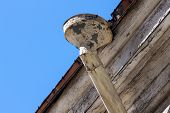 stock photo of downspouts  - Rain gutters on old home - JPG