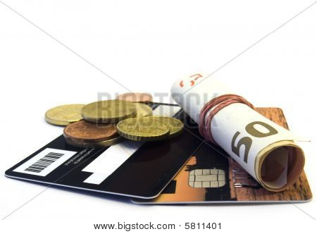 Credit card and money on white background