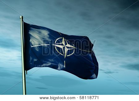 NATO flag waving in the evening