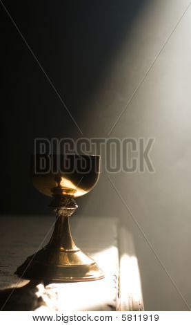 Gold Chalice In Altar With A Ray Of Divine Light