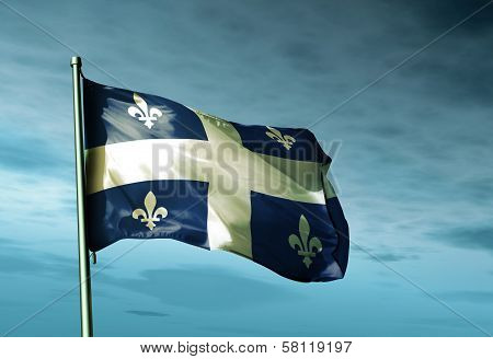Quebec (Canada) flag waving in the evening