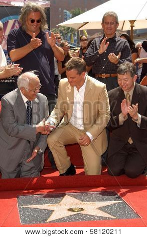 Johnny Grant and Paul Greengrass with Matt Damon and Leron Gubler at the award ceremony honoring Matt Damon with a star on the Hollywood Walk of Fame. Hollywood Blvd., Hollywood, CA. 07-25-07