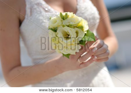 Nice Bride's Hands Holding Wedding Bouquet Of Yellow Roses