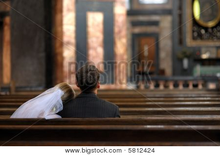Bride And Groom Sitting In The Church