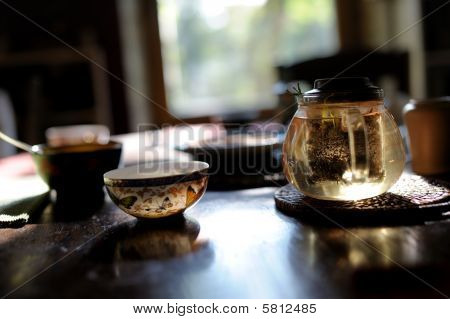 China Tea Cups And Glass Teapot On The Table