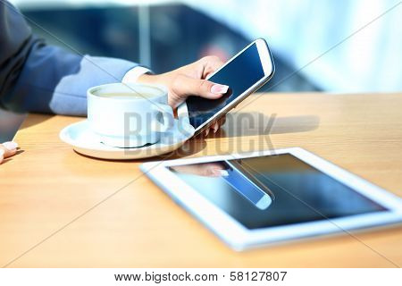 Modern workplace with digital tablet computer and mobile phone cup of tea