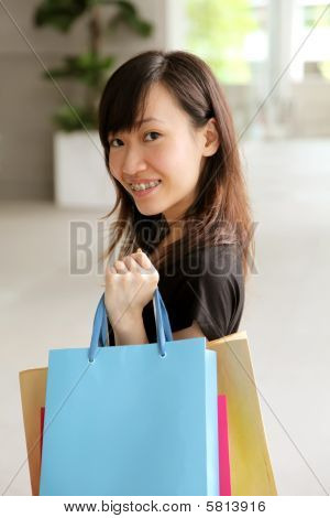 Teenager With Shopping Bags