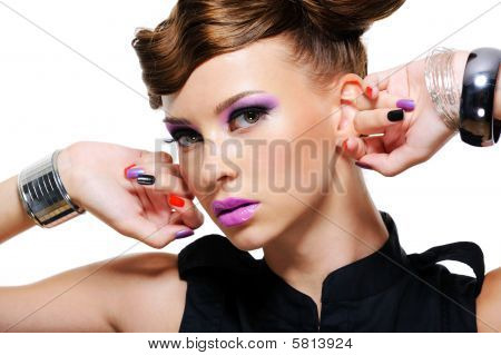 Portrait Of Beautiful Woman With Purple Make up