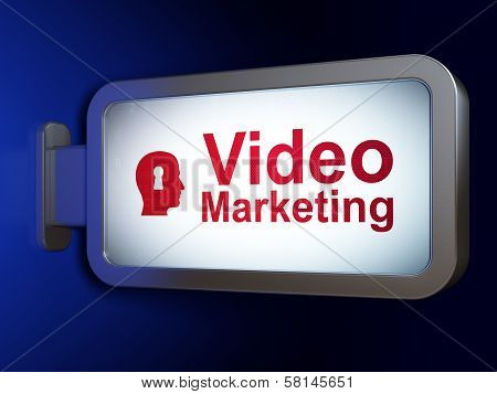 Business concept: Video Marketing and Head With Keyhole on billboard background