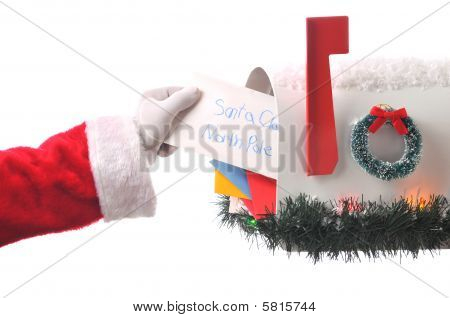 Santa Claus Taking Letter From Mailbox