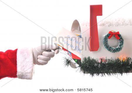 Santa Claus Opening Mailbox