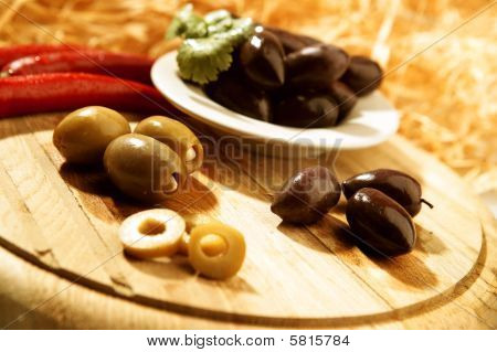 Olives On A Wooden Board