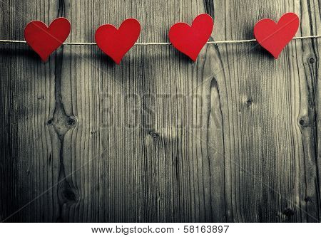 Heart-shaped clips are hanging on the rope Valentine's Day love wallpaper