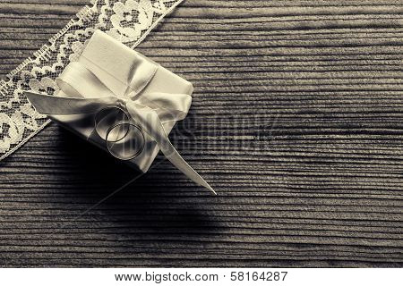 Engagement ring with gift box white lace - wood background