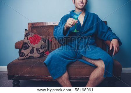 Young Playboy In Dressing Gown Toasting With Cocktail