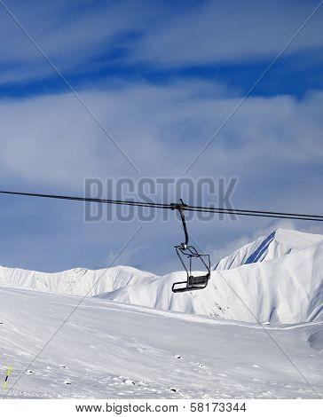 Chair Lift And Off-piste Slope At Nice Sun Day