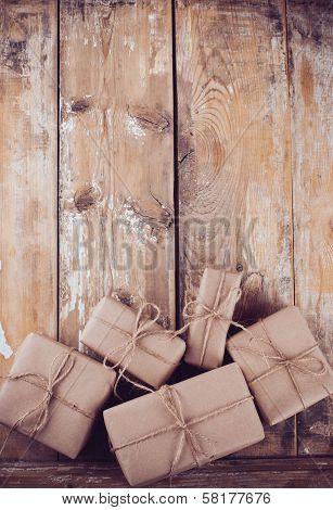 Gift Boxes, Postal Parcels On Wooden Board