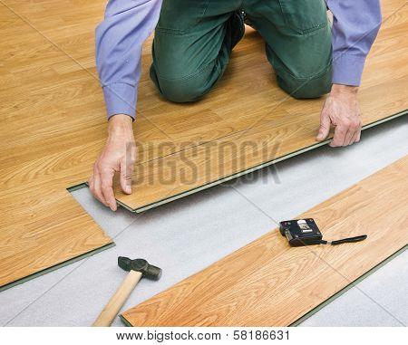 Man Laying Laminated Panels Color Of Wood